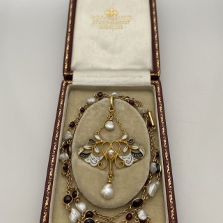 A Carlo Giuliano garnet, pearl and diamond pendant and chain.