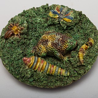 A Green Palissy Ware Plate