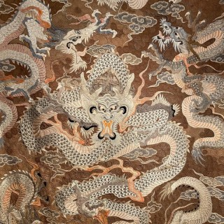 An exceptional and large Japanese silk embroidery of dragons in flight