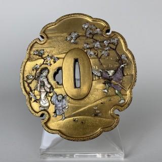 An amusing Japanese Meiji Period, gold lacquer tsuba with Shibayama style decoration