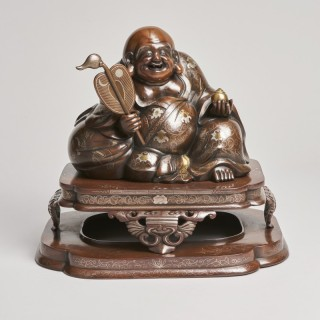 A fabulous, large Bronze and multimetal Okimono of Hotei