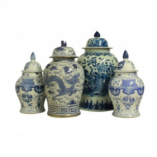 A COLLECTION OF FOUR LARGE CHINESE VASES WITH COVERS