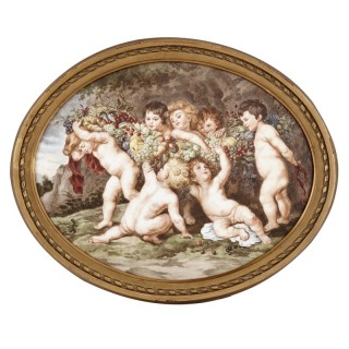 Oval porcelain plaque with a painted scene after Rubens
