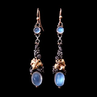 A pair of Dorrie Nossiter arts and crafts moonstone earrings