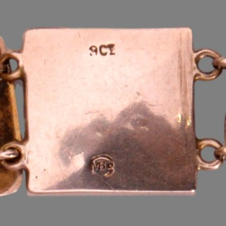 A gold Murrle Bennett arts and crafts bracelet