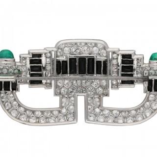 Art Deco onyx, diamond and emerald brooch, circa 1925.