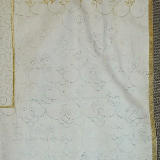 An early 18th century English embroidered coverlet