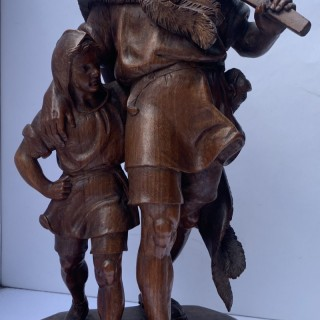 Black forrest carving of William Tell and son