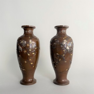A pair of Bronze Meiji-era Japanese vases signed Nogawa