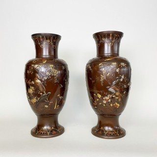 A spectacular pair of Meiji period multi-metal vases signed Inoue of Kyoto