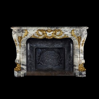A Monumental Brèche Violette Fireplace In the Louis XV Manner