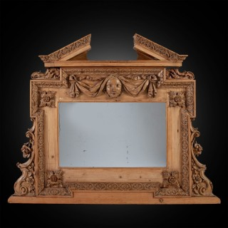 A George II pine overmantel mirror in the manner of William Kent