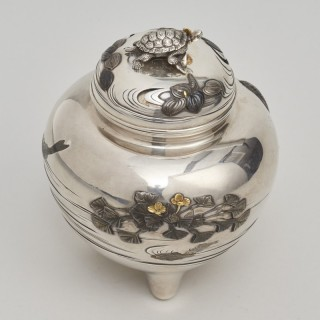 A Japanese Meiji Period Silver Koro decorated with carp and tortoise