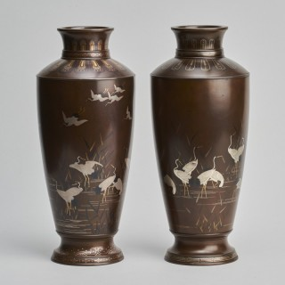A pair of stylish Meiji Period Japanese bronze vases with crane decoration