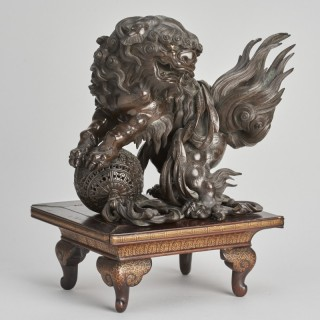 A characterful Japanese Meiji period bronze of a Lion Dog