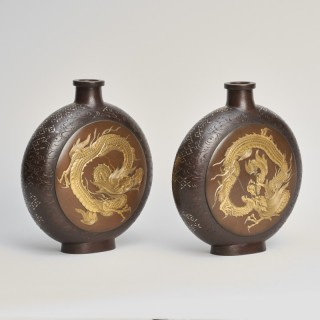 A pair of Japanese Meiji Period bronze moon flask vases