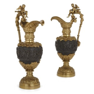 Pair of patinated bronze and ormolu ewer vases