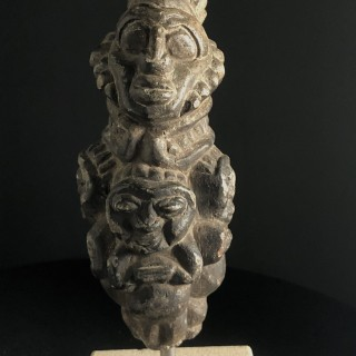 Early carved stone head with 3 lower figures, Mexican