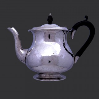 A Sibyl Dunlop silver arts and crafts teapot