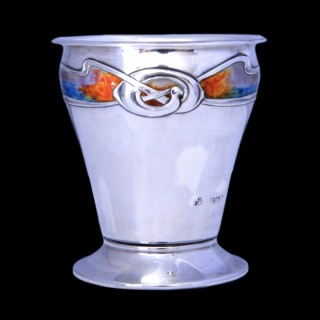 An art nouveau silver and enamel vase in the style of Archibald Knox