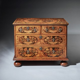A William and Mary walnut floral marquetry chest, circa 1690.