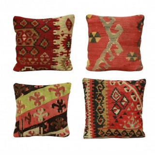 A SET OF FOUR XIX CENTURY KILIM CUSHIONS