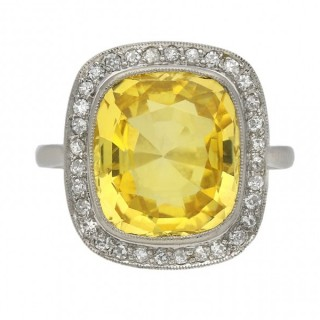 Ceylon yellow sapphire and diamond coronet cluster ring, circa 1920.