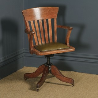 Antique American Edwardian Oak & Green Leather Revolving Office Desk Arm Chair by Heywood Brothers & Wakefield Co., (Circa 1910)
