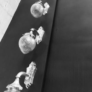 A SET OF FOUR SILVER BRACKET SCONCES