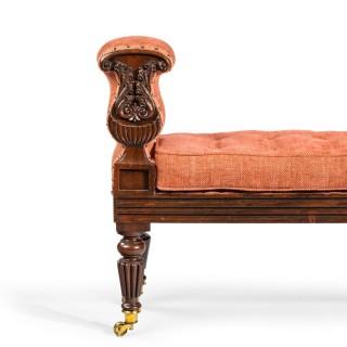 A late Regency rosewood window seat, in the manner of George Oakley