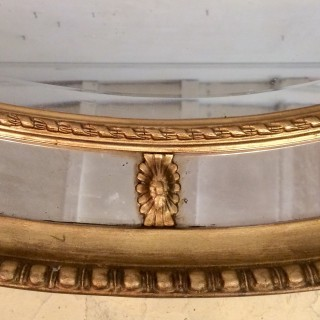 19th century oval carved giltwood wall mirror.
