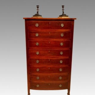 A small  19th century bow fronted chest of drawers.