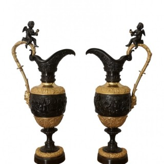 PAIR OF 19TH CENTURY FRENCH BRONZE AND GILT EWERS