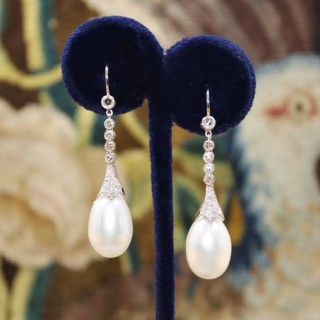 A fine pair of Pearl and Diamond Earrings set in 18ct White Gold, Pre-owned