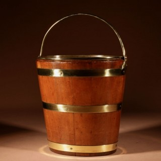 A Dutch Coopered Oval Mahogany and Brass Tea Bucket/Jardinière, 19th century