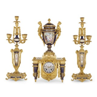Neoclassical style porcelain and gilt bronze clock set by Barbedienne