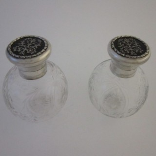 Pair of Antique George V Sterling silver and tortoiseshell scent bottles