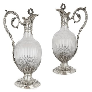 Pair of Rococo style silver mounted crystal jugs by Boivin