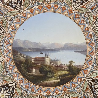 Swiss charger-shaped faience plaque depicting a lakeside chateau