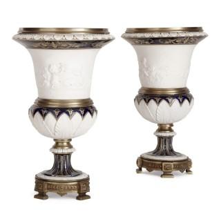 Pair of gilt bronze mounted krater-form bisque porcelain vases