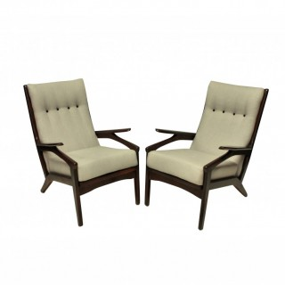 A PAIR OF MID CENTURY DANISH ARMCHAIRS