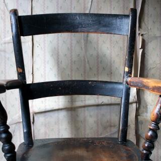 A Mid-19thC Black Painted Elm Farmhouse Kitchen Armchair c.1860