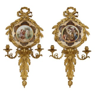 Pair of Italian porcelain and gilt bronze sconces by Pauly & Co