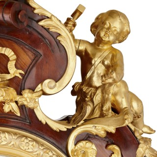 Gilt bronze and parquetry standing clock by Kahn in the Régence style