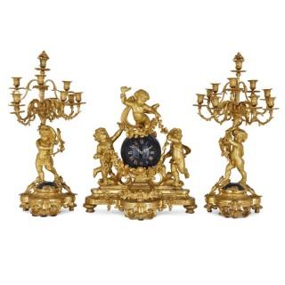 Large cherub-themed gilt bronze clock garniture by Popon