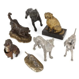 Collection of seven metal dogs of various types