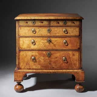 An extremely rare George I walnut  chest of small proportions on ball and bracket feet