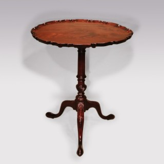 A Chippendale period mahogany piecrust tripod table