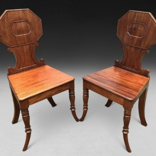 Unusual pair of Regency Period Mahogany Hall Chairs