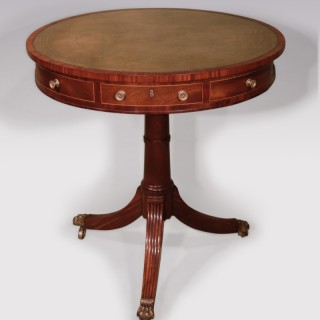 A George III period mahogany drum table